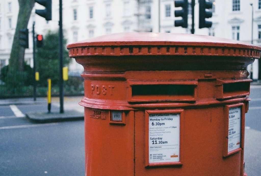 Postbox where postman stole stamps debt collection solicitors in Brighton