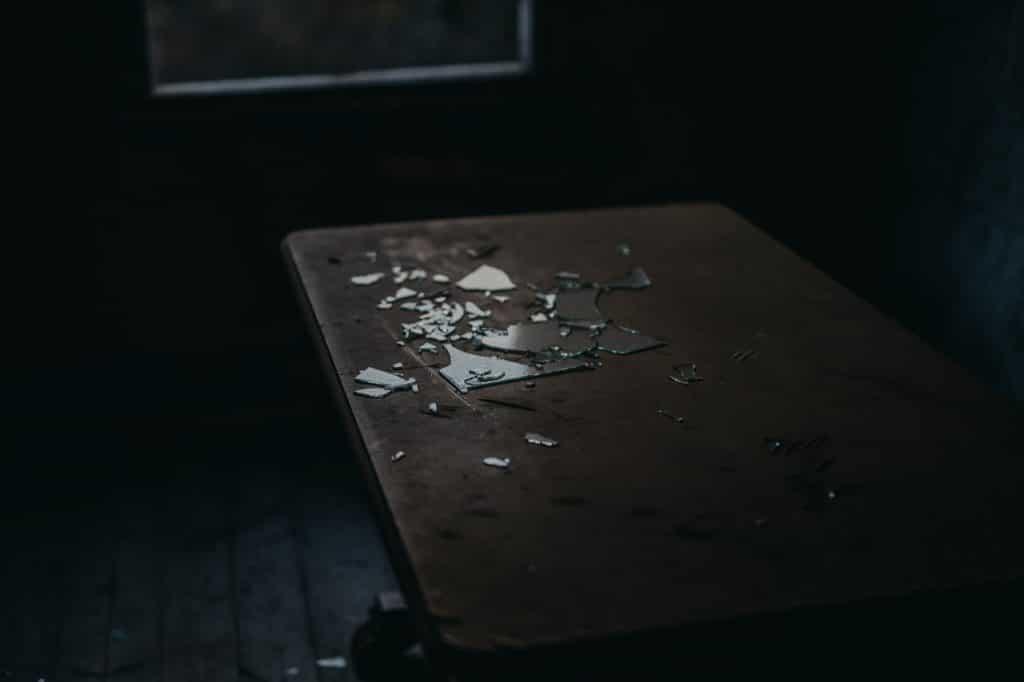 Broken glass that a women put in her husbands bed