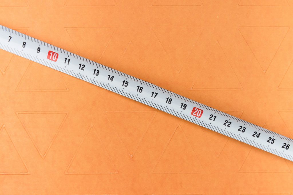 Tape measure showing height as an indirect discrimination