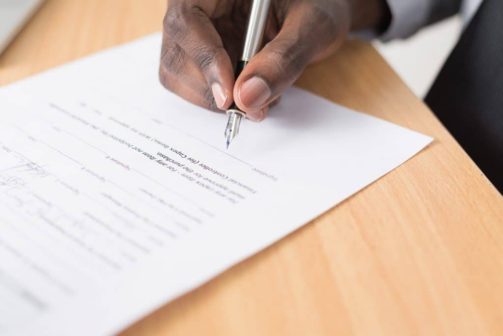 Man who is is trying to forge a signiture on a will