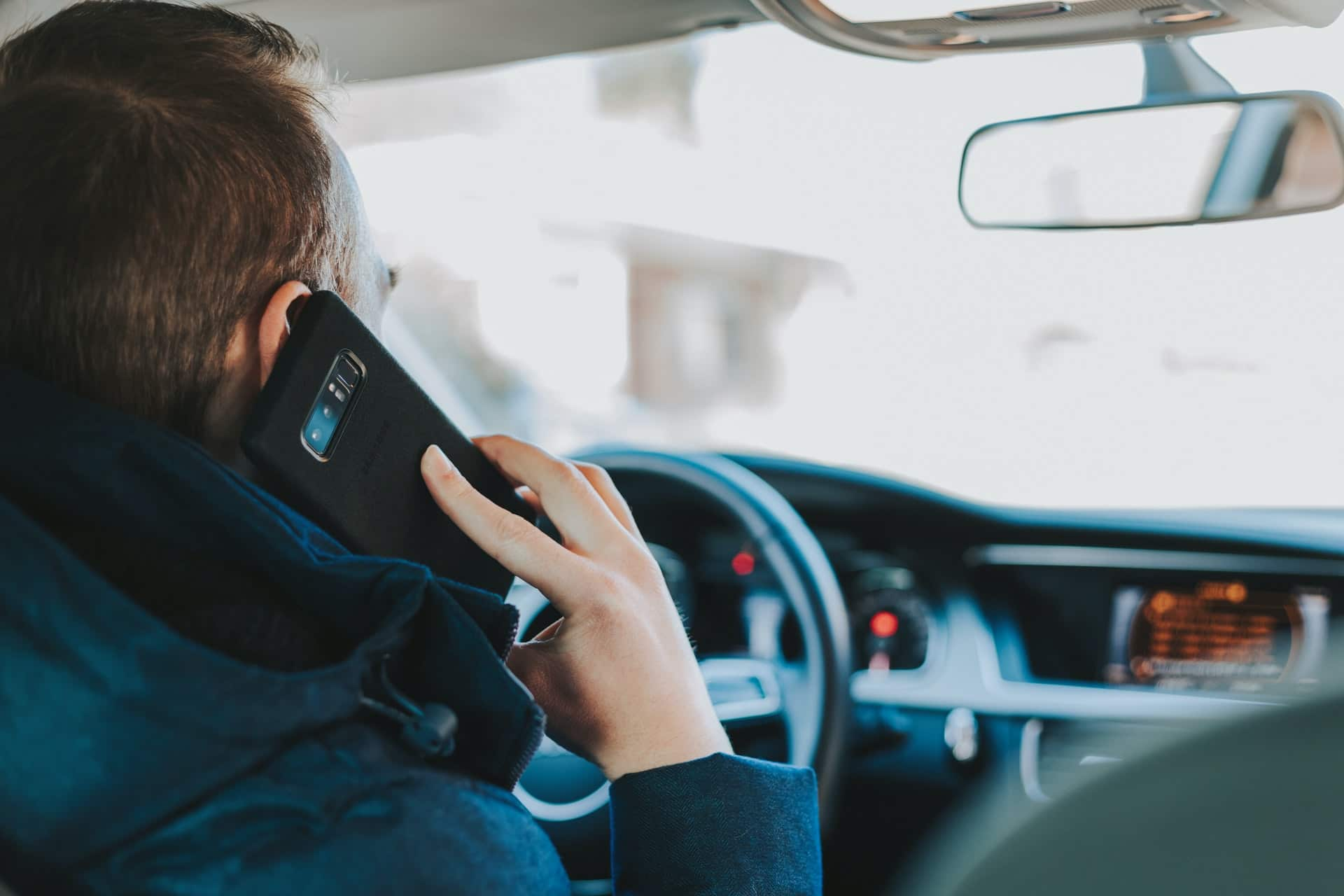 Breaking the law by using your phone while driving