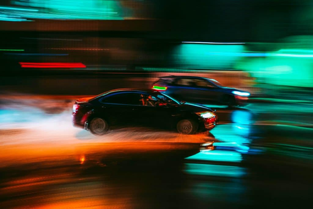 Two cars which are racing at traffic lights which is considered dangerous driving 1